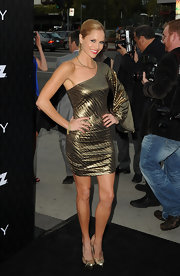 Ellen Hollman was a brazen beauty at the 'Magic City' premiere in this metallic winged dress.
