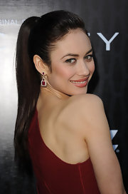 Olga Kurylenko attended a premiere of 'Magic City' wearing her hair in a sleek ponytail. The simple style paired perfectly with her red frock and sparkling jewels.