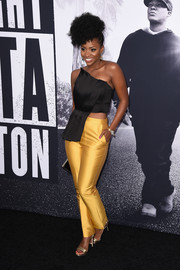 Teyonah Parris was bold and chic in a pleated black one-shoulder crop-top by Keepsake The Label at the premiere of 'Straight Outta Compton.'