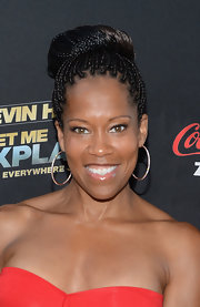 Regina King attended the 'Kevin Hart: Let Me Explain' premiere wearing her hair in an intricate braided bun.