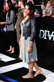 Lisa Bonet opted for a pair of distressed nude gladiator sandals to complete her look.