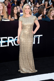 Kristen Quintrall shone in a sophisticated gold sequined gown during the 'Divergent' premiere.