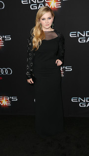 Abigail Breslin looked modest yet elegant in a black sheer-panel Halston Heritage gown with embellished sleeves during the Hollywood premiere of 'Ender's Game.'