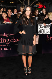 Genesis Rodriguez stepped out at the premiere of 'Breaking Dawn' wearing a long-sleeve A-line dress with peek-a-boo sheer skirt hem.