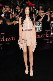 Kylie Jenner opted for a beige dress with an asymmetrical hem at the 'Twilight' premiere. She topped off her look with ivory T-strap platform sandals.