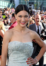 Julia Jones paired her beaded strapless dress with a center part sleek bun.