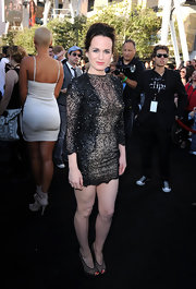 The 'Twilight' mom looked smokin' in a short, beaded cocktail dress with sexy sheer pumps.