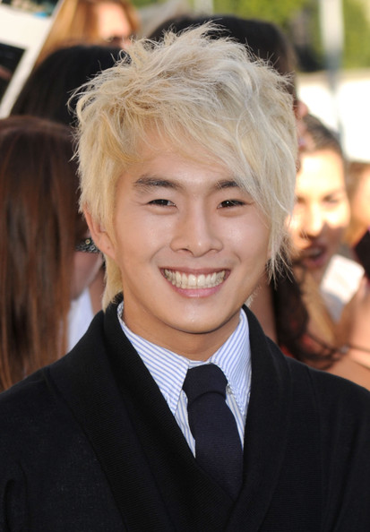 Justin Chon showed off his bleach blonde messy cut while walking the red carpet.