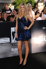 Marisa Miller paired her sequined cocktail dress with black pumps and beach waves.