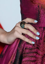 Christian's baby blue nails popped against her sparkly purple dress.