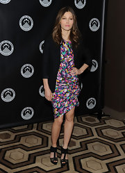 Ms. Biel completes her vibrantly printed dress with a black blazer and a pair of black suede t-strapped sandals.