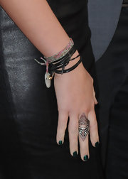 Miley Cyrus showed off a metallic shade of green polish at the premiere of 'The Last Song.'