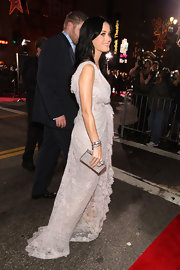 Katy added subtle shine to her Elie Saab couture gown with a pair of pavé diamond bangle bracelets.