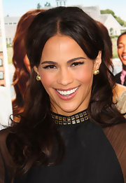 Paula Patton attended the premeire of 'Jumping the Broom' wearing a pair of 18-karat gold Glamazon Pin Ball stud earrings.