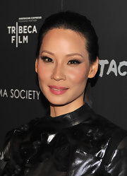 Lucy Liu attended the premiere of 'Detachment' wearing a shiny warm pink lipstick.