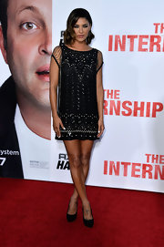Jessica Szohr channeled Art Deco elegance with this black shift dress that featured embellished designs and mesh sleeves.