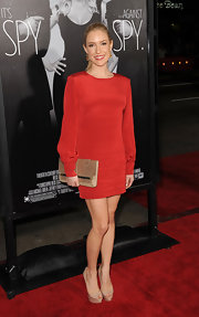 K. Cav paired her red mini dress with nude platform peep-toe pumps.