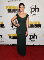 Gemma Arterton went for Old Hollywood glamour in a curve-hugging emerald-green evening dress during the 'Runner Runner' premiere.