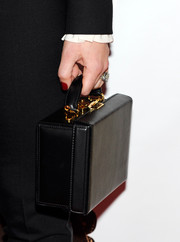 Jessica Biel attended the 'Runner Runner' premiere carrying a black leather purse that looked like a tiny briefcase.