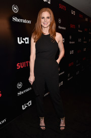 Sarah Rafferty kept it understated in this black halter jumpsuit at the premiere of 'Suits' season 5.