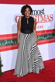 Mo'Nique looked effortlessly stylish in a Tyrell Holmes gown, featuring a plain black bodice and a boldly striped skirt, at the premiere of 'Almost Christmas.'