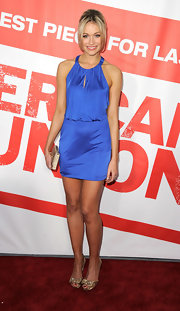 Katrina Bowden paired her azure frock with a pretty pair of metallic gold peep toe pumps for the premiere of 'American Reunion.