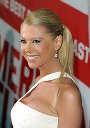 Tara Reid swept back her blond tresses into a super-sleek wrapped ponytail for the 'American Reunion' premiere.