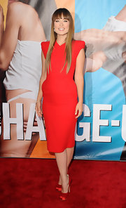 Olivia Wilde donned a red hot frock for the premiere of 'The Change-Up.' She finished off the look with a super sleek and trendy 'do.
