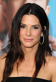 America's sweetheart, Sandra Bullock, paired her Lanvin jumpsuit with full lashes and a silver eyeshadow.