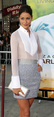 Amanda Crew paired her silver beaded skirt with a white sheer blouse.