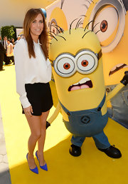 Kristen Wiig kept it simple yet sassy with this white blouse and black shorts combo at the premiere of 'Despicable Me 2.'