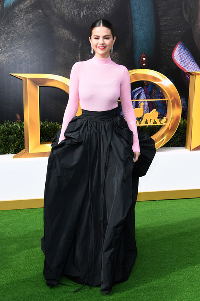Selena Gomez added a glamorous touch with a long black silk taffeta skirt, also by Givenchy Couture.