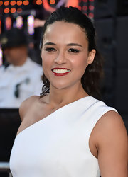 A deep crimson lip color looked gorgeous against Michelle Rodriguez's olive skin.