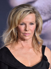 Kim Basinger rocked teased waves with side-swept bangs when she attended the premiere of 'Fifty Shades Darker.'