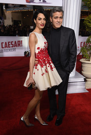 Amal Clooney cut an ultra-girly figure in a flower-appliqued fit-and-flare dress by Giambattista Valli Couture at the premiere of 'Hail, Caesar!'