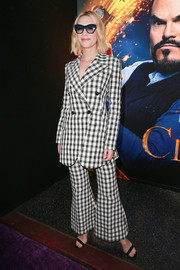 Cate Blanchett showed her quirky side with this gingham jacket and flared pants combo by Derek Lam at the premiere of 'The House with a Clock in Its Walls.'