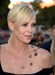 Charlize Theron wore a simple ponytail with side-swept bangs at the premiere of 'The Huntsman: Winter's War.'