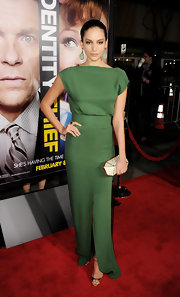 Genesis Rodriguez looked sleek and sophisticated wearing a green dress with a knee-high front slit at the 'Identity Theft' premiere.