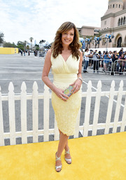 Allison Janney paired her lovely frock with silver crisscross-strap sandals.