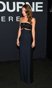 Alicia Vikander sported her favorite brand, Louis Vuitton, at the 'Jason Bourne' premiere: a strapless navy number with a pair of midriff cutouts and black sequin detailing.