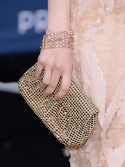 Andrea Riseborough chose a pink and gold beaded bracelet for her fun and feminine red carpet look.