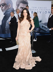 Andrea Riseborough stunned at the 'Oblivion' premiere, where she wore this blush-colored gown, featuring floral applique detailing and a full skirt and train.