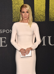 Anna Camp accessorized with a pearlescent box clutch by Edie Parker when she attended the premiere of 'Pitch Perfect 3.'