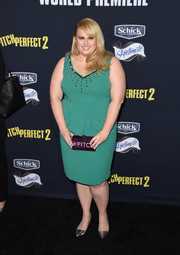Rebel Wilson chose a green Marina Rinaldi cocktail dress with an embellished neckline and a peplum waist for her 'Pitch Perfect 2' premiere look.