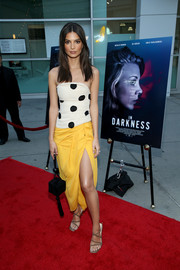 Emily Ratajkowski accessorized with a black suede box bag by Carolina Santo Domingo.