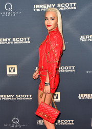 Rita Ora rocked all red at the premiere of 'Jeremy Scott: The People's Designer' with this Moschino quilted leather bag and short suit combo.