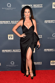 Katy Perry put lots of skin on display in this low-cut, high-slit black halter gown by Moschino at the premiere of 'Jeremy Scott: The People's Designer.'