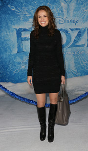 Amy Brenneman looked warm and stylish in a black sweater dress during the premiere of 'Frozen.'