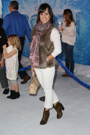 Constance Zimmer looked warm and comfy in a brown fur vest during the premiere of 'Frozen.'