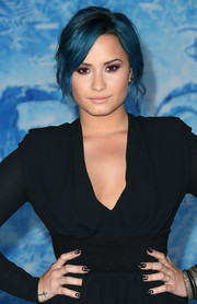 Demi Lovato matched her LBD with black and gold nail art for the premiere of 'Frozen.'